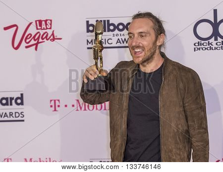 LAS VEGAS - MAY 22 : Recording artist David Guetta winner of the Top Dance/Electronic Artist award poses in the press room at the 2016 Billboard Music Awards at T-Mobile Arena on May 22 2016 in Las Vegas