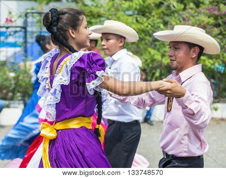 PANCHIMALCO EL SALVADOR - MAY 08 : Salvadorian dancers perform during the Flower & Palm Festival in Panchimalco El Salvador on May 08 2016