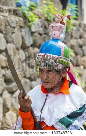 """PANCHIMALCO EL SALVADOR - MAY 08 : A member of a dance group """"Los Historiantes"""" perform during the Flower & Palm Festival in Panchimalco El Salvador on May 08 2016"""