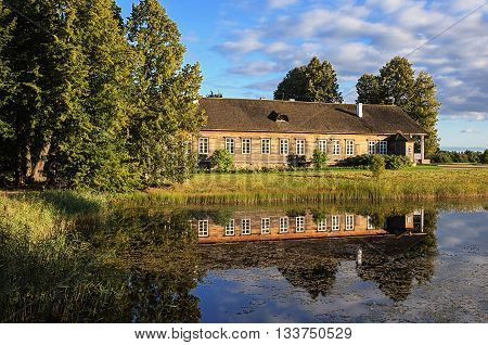 Manor house and pond at sunset village Trigorskoye Pushkinskiye Gory Reserve Russia