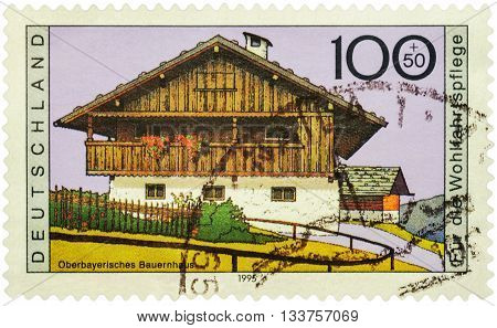 MOSCOW RUSSIA - JUNE 02 2016: A stamp printed in Germany shows Upper Bavarian farmhouse series