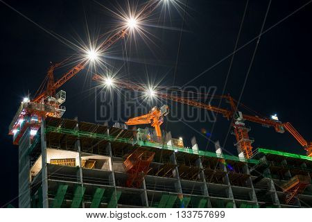 Nighttime With Building And Crane