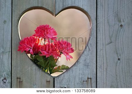 wooden heart shape with flowers with copy space