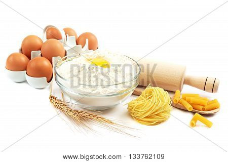Flour eggs pasta baking ingredients for cooking isolated on white background.