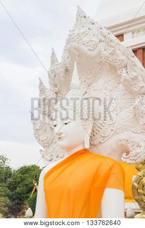 White buddha status in Thailand public temple stock photo