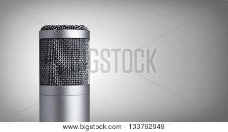 Close up vintage microphone on gray background