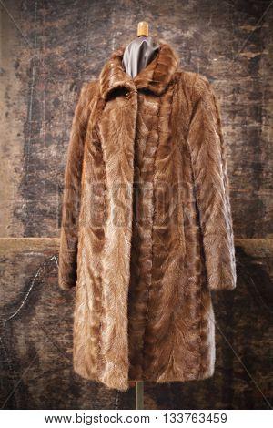 Long mink coat on a mannequin . poster