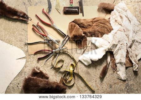 Workshop furrier, utensils, tools and pieces of natural fur