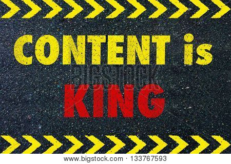 CONTENT IS KING message on road for business concept