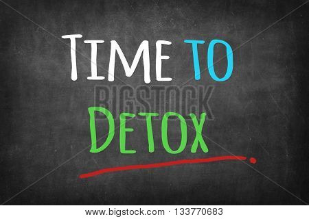 Time to Detox colorful word on black blackboard background