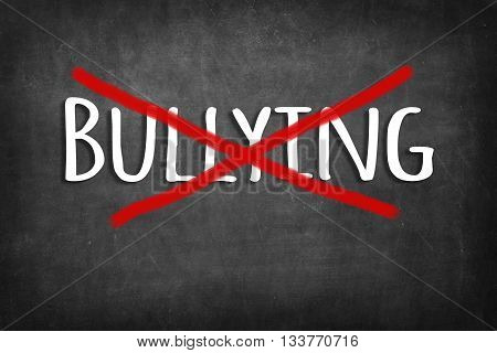 (stop) bullying chalk word on black blackboard background