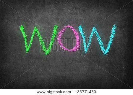 Wow colorful word on black blackboard background