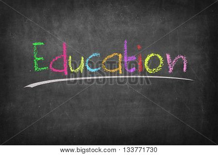 Education colorful word on black board background