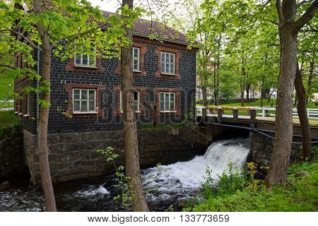 An old watermill and a small bridge in Fiskars Finland. Late spring.