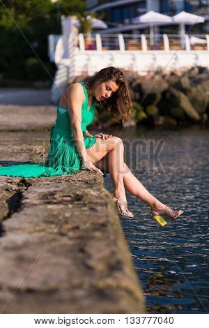 Stylish Woman Relaxing By The Sea At Hot Summer Day
