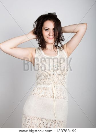 beautiful brunette woman tearing her hair and looks shocked. girl flirting concept. expression of different emotions.