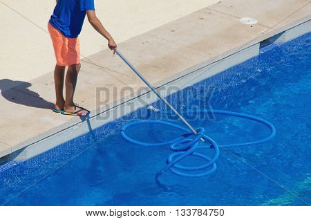 Janitor Cleaning The Swimming Pool