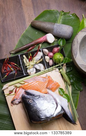 Salmon Head And Group Of Tomyum(thai Food) Seasoning Ingredients. Salmon Head Tomyum Ingredients.raw