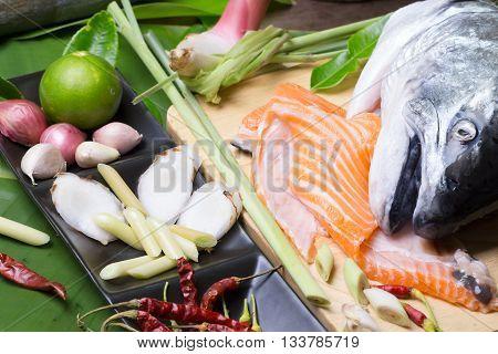 Salmon Head And Group Of Tomyum(thai Food) Seasoning Ingredients. Salmon Head Tomyum Ingredients.raw