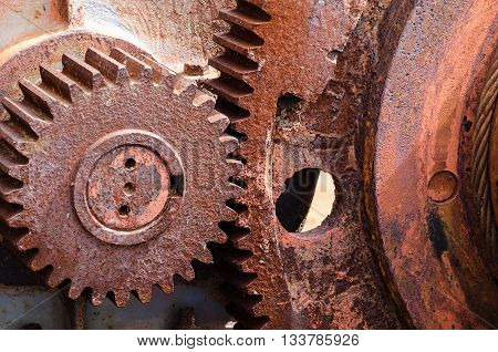 Rusty vintage cog wheel of the industrial winch. Close up.
