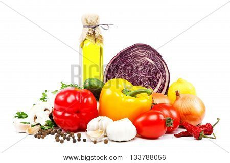 Fresh vegetables and olive oil isolated on a white background.
