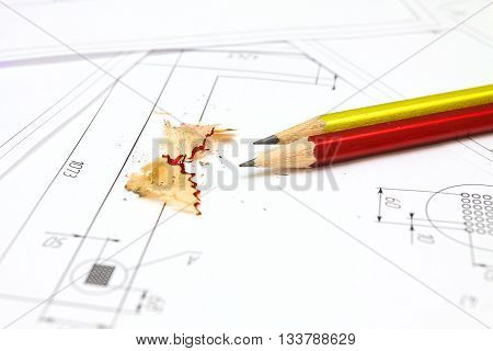 Two pencisl plans and blueprints for an architect's design drawings