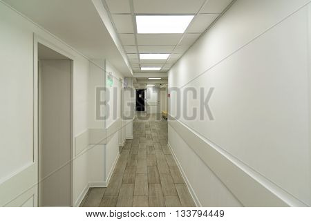an empty white a corridor in hospital