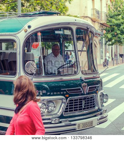 TARRASA BARCELONA SPAIN - MAY 13 2012: Unidentified Man driving Pegaso Comet 5061 of 1964 bus on parade of vintage vehicles in the modernist fair held every year in the city.