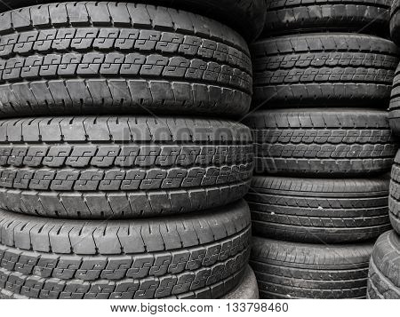 Close up stacks of old used tires. Texture