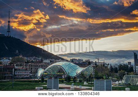 Tbilisi Georgia - April 24 2015. Modern Bridge of Peace over Kura River designed by Michele De Lucchi