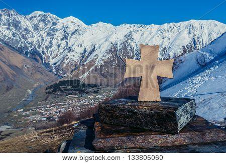 Gergeti Georgia - April 25 2015. Small shrine near famous landmark Tsminda Sameba church (english: Holy Trinity) near Gergeti village. Stepantsminda town on background