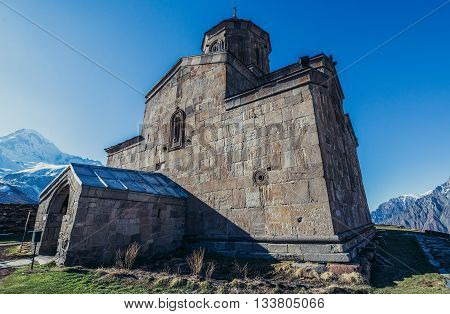 Gergeti Georgia - April 25 2015. Famous landmark Tsminda Sameba church (english: Holy Trinity) near Gergeti town in Georgia