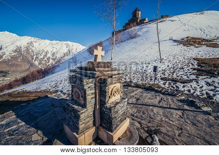 Gergeti Georgia - April 25 2015. Small shrine near famous landmark Tsminda Sameba church (english: Holy Trinity) near Gergeti town in Georgia