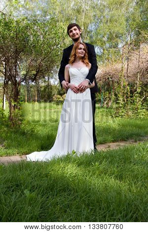 Beautiful young couple bride and groom tenderness and love