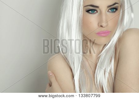 beautiful fantasy woman with blue eyes and platinum hair, studio portrait