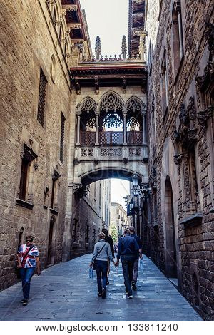 Barcelona Spain - May 22 2015. People walks on back alley next to Palace of the Government of Catalonia