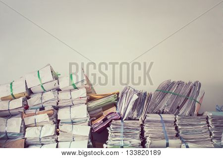Stack of business report paper files on the document racksin vintage style