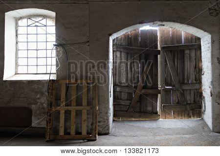 old wooden door inside old garnar, vintage