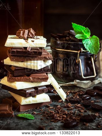 Chocolate / Chocolate bar / chocolate background/chocolate tower and strawberry. Dark background. Selective focus.