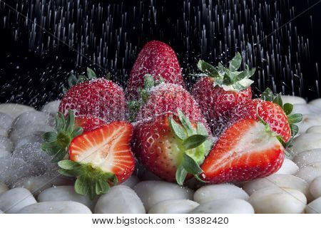 Sugar falling all over strawberries