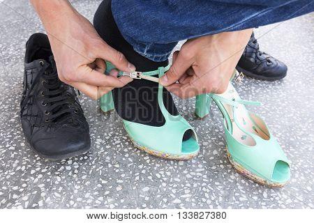 Man Putting On Ladies Shoes