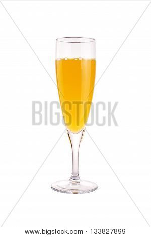 Glass of champagne bellini isolated on white
