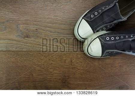 Grey Casual Shoes On A Wooden Floor