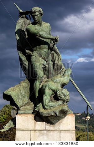 TURIN ITALY - APRIL 24 2016: Bronze statue depicting Valor on the Battlefield was added to the Ponte Umberto I bridge in Turin Italy by Luigi Contratti in 1911