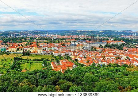 2014-07-09 Prague Czech republic - photo of view from the 'Petrinska rozhledna' tower to nice historical city Prague in Europe with monuments 'Prazsky hrad' castle and 'Chram svateho Vita' cathedral during sunny summer weather