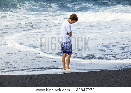 Boy Watches The Spume Of The Ocean