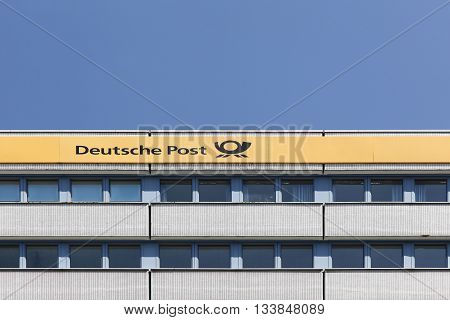 Kiel, Germany - June 4, 2016: German post called Deutsche Post in German. Deutsche Post  operating under the trade name Deutsche Post DHL, is a German courier company and the world's largest
