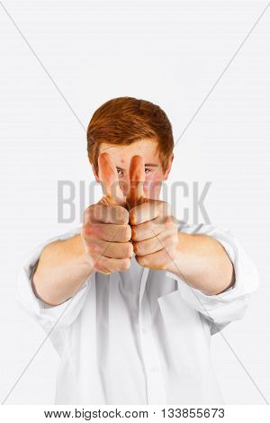 Boy Showing I Like It Sign With Thumbs Up