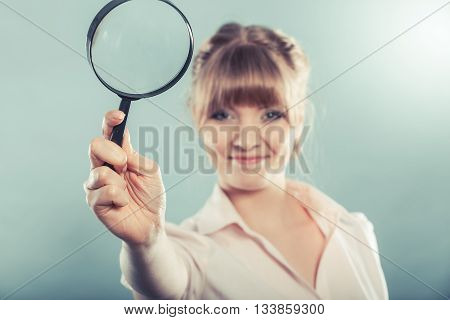 Woman Holding Magnifying Glass