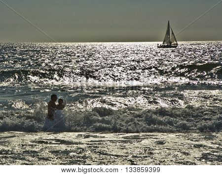 bathing in sunset in waves at the beach of Redondo California